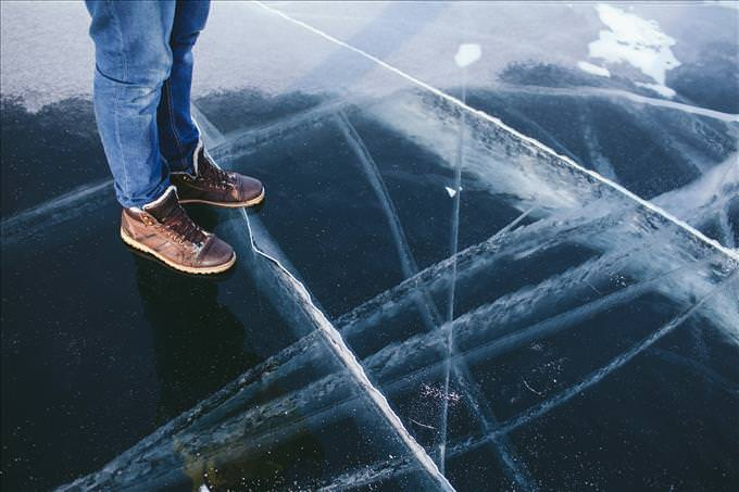 man standing on thin ice