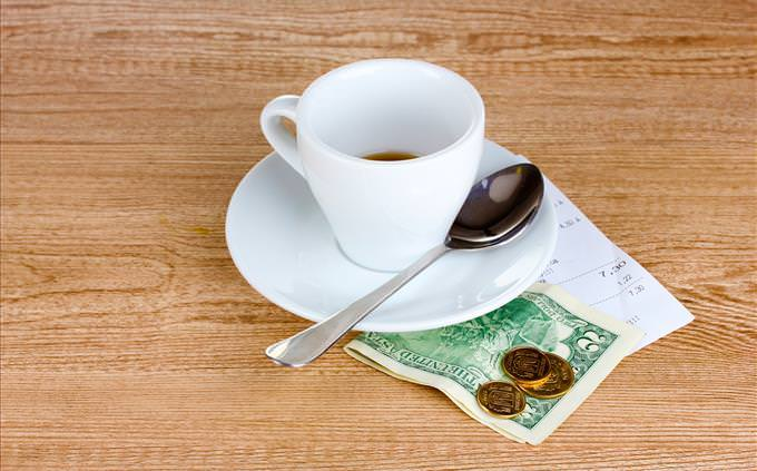 tip under coffee cup