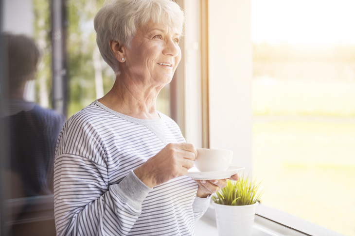5 Practical and Easy Ways to Express Gratitude, senior woman with mug looking out the window