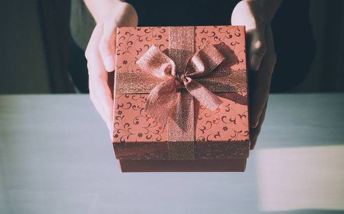 Hands giving gift
