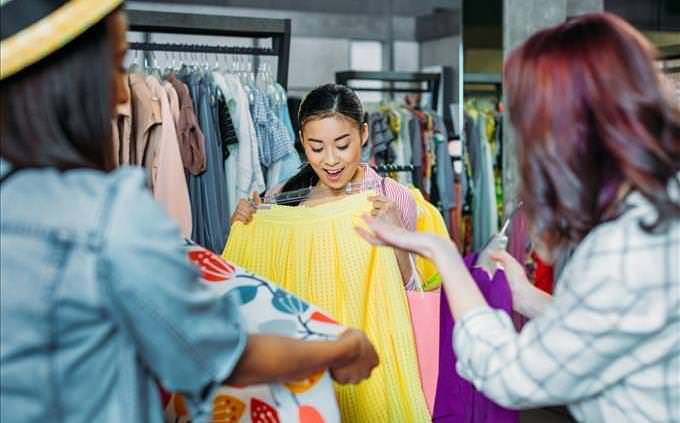 young women buying clothes