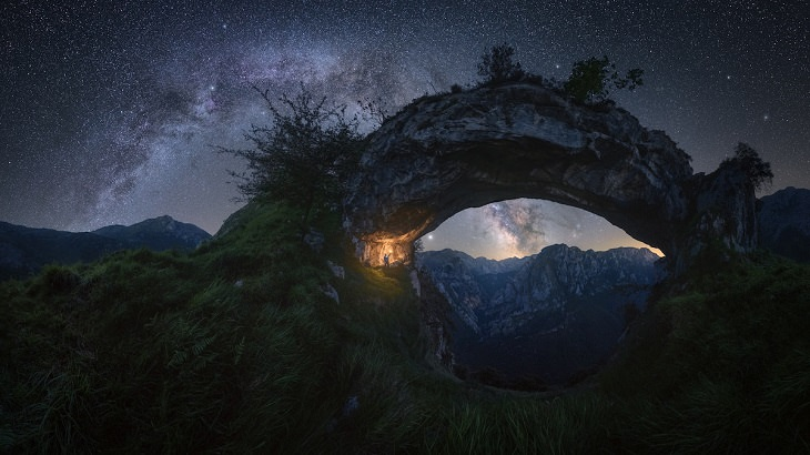 "Best and colorful photographs of the Milky Way taken from different locations around the world, provided by Capture the Atlas editor Dan Zafra, ""Double Arch"" by Pablo Ruiz García, in ""La Hermida"" gorge in the Picos de Europa, Spain"