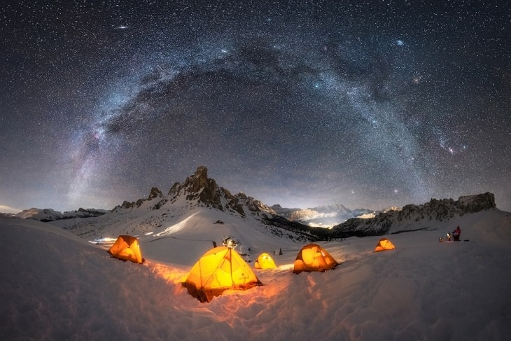 "Best and colorful photographs of the Milky Way taken from different locations around the world, provided by Capture the Atlas editor Dan Zafra, ""Base Camp"" by Giulio Cobianchi, at the Dolomites, Italy"