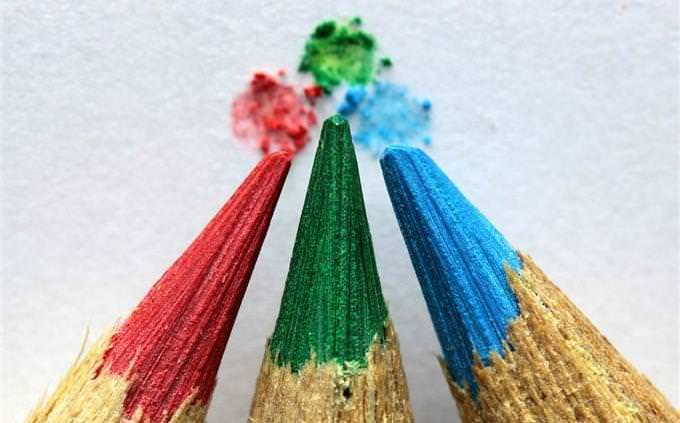 Colorful pencils touching tips