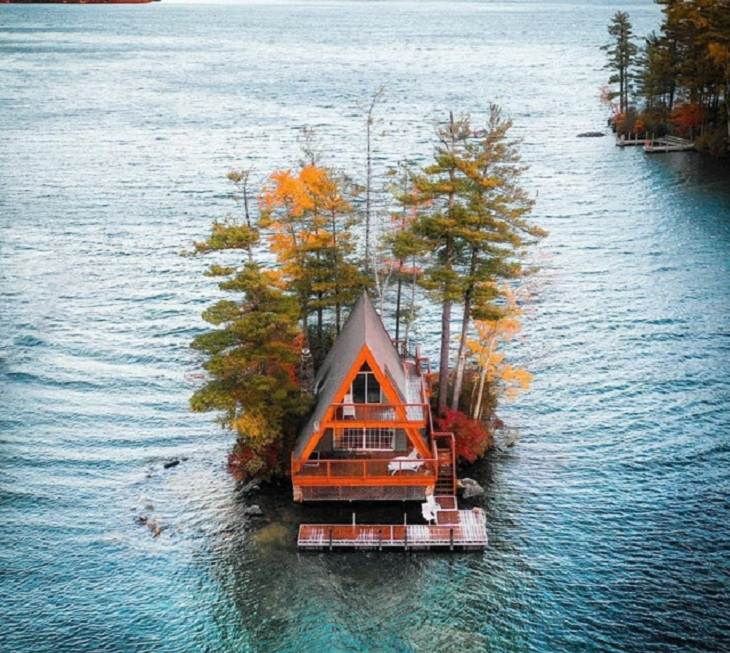 "Beautiful artistic creations made by humankind and civilization over time, ""The A Frame"" and it's floating dock, on Lake Winnipesaukee, New Hampshire"
