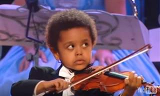Será que este menino é o futuro Andre Rieu?